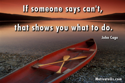 A motivational picture of canoe on the shore with the quote: If someone says can't, that shows you what to do By: John Cage