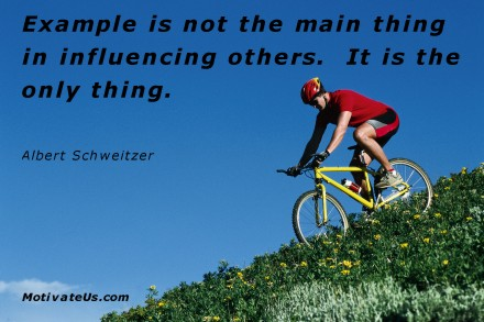 A motivational picture of bike rider going down hill with the quote: Example is not the main thing in influencing others.  It is the only thing. By: Albert Schweitzer