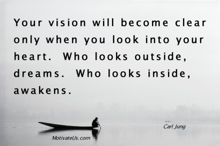 A motivational picture of man in a boat with the quote: Your vision will become clear only when you look into your heart.  Who looks outside, dreams.  Who looks inside, awakens. By: Carl Jung